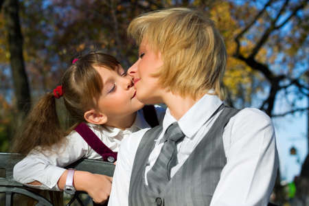 Mother and daughter kissing Stock Photo - 8861188