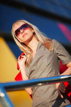 window shades: Young businesswoman against office windows