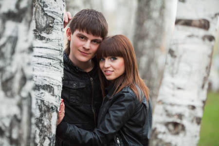 Young couple in the birch forest photo