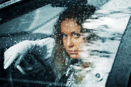 Young woman looking through the car window photo