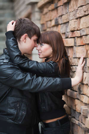 Young couple against a brick wall Stock Photo - 9032018