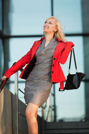 Young businesswoman against office windows photo