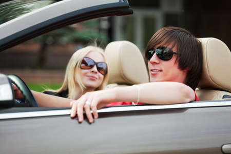 Happy young couple in the convertible  photo