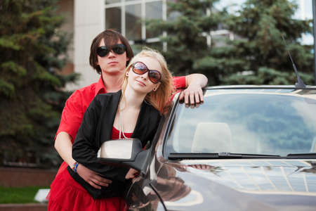 Young couple with a new convertible car photo