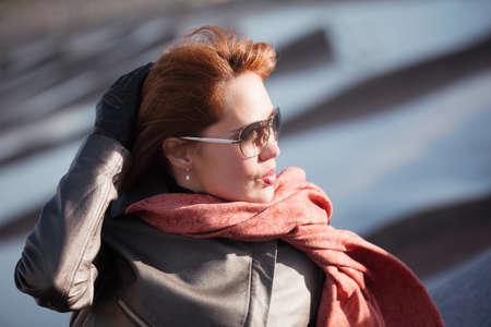 Beautiful woman in red scarf  photo