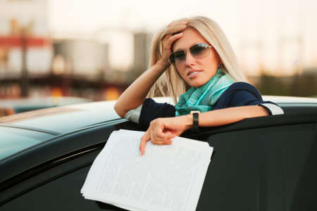 Tired businesswoman with financial reports  photo