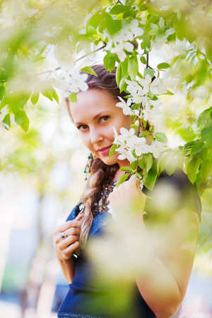 Beautiful woman in a spring garden photo