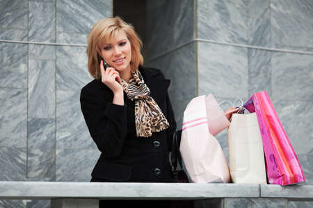 Young blond shopper on the phone Stock Photo - 9172377