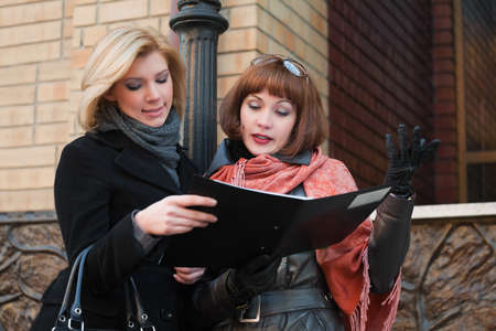Young businesswomen reading a financial reports photo