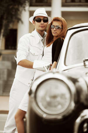 Young couple with a retro car  photo