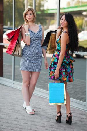 Two young women shopping photo