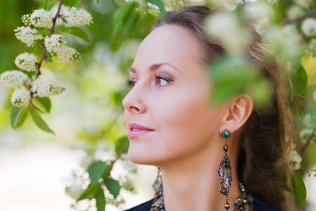 Beautiful woman in a spring garden photo