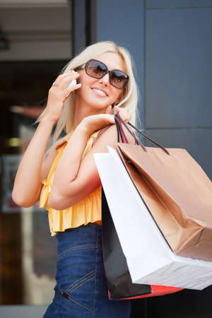 retail scene: Happy shopper calling on the phone