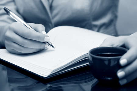 pad and pen: Businesswoman writing