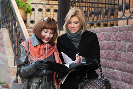 Young businesswomen with financial reports photo