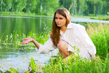 ponds: Young woman relaxing by the lake