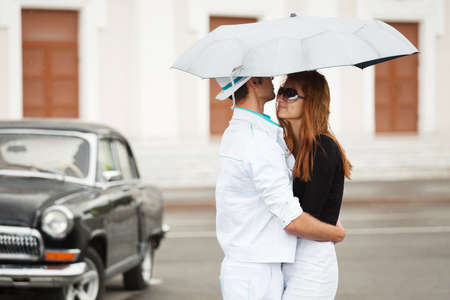 Young couple with umbrella photo