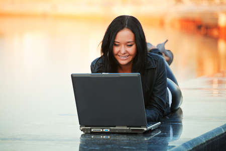 Young woman working on laptop photo