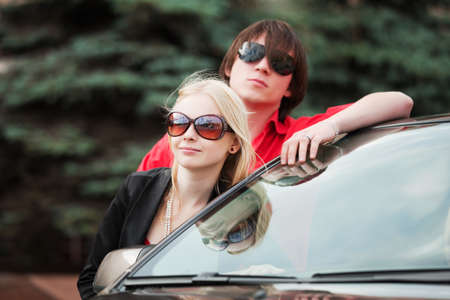 Young couple with a new convertible car Stock Photo - 9312478