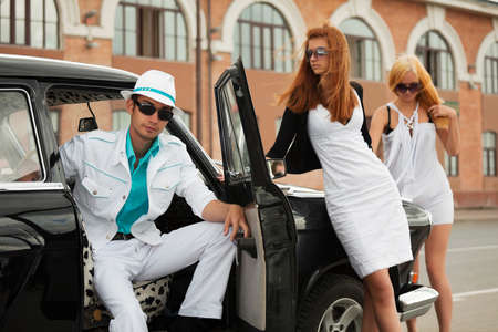 Young people with a retro car Stock Photo - 9327254