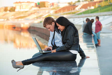 Young couple working on laptop photo