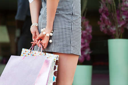 Female hands holding a shopping bags photo