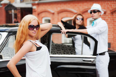 Young people with a retro car  Stock Photo - 9538361