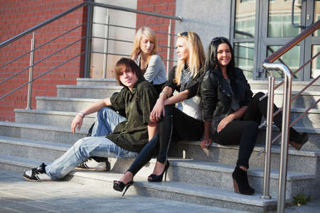 laze: Young people relaxing on the steps