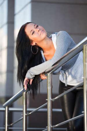 Beautiful young woman daydreaming photo