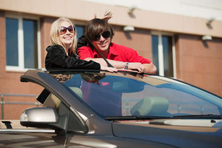Happy young couple in the convertible car photo