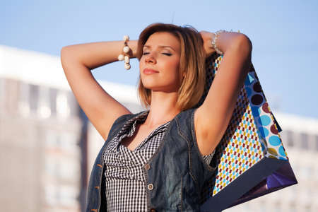 Young woman with shopping bags Stock Photo - 9730734