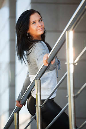 Beautiful woman leaning on the handrail photo