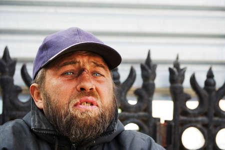 Homeless man on a city street photo