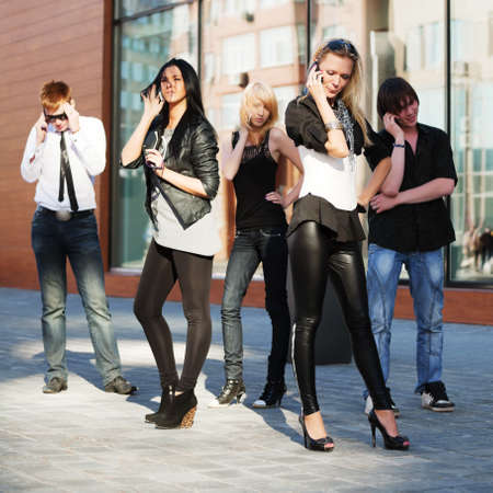 street fashion: Young people calling on the mobile phones