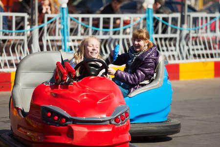 amusement: Teens driving a bumper cars