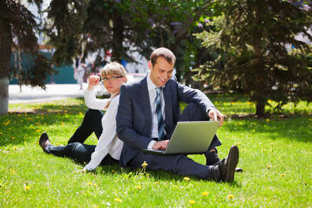 Young business people with laptop photo