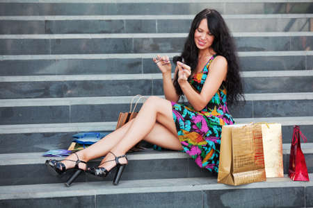 Young woman sitting on a mall steps photo