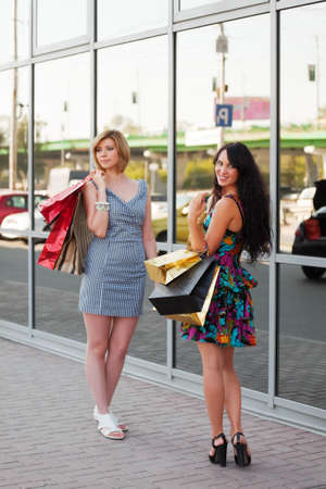 Two young women with shopping bags photo