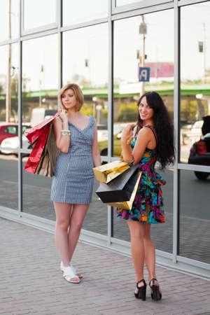 window shopper: Two young women with shopping bags Stock Photo