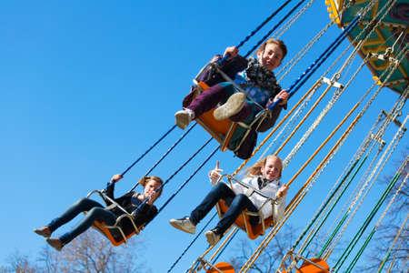 chairoplane: Teenage girls on the chain swing carousel
