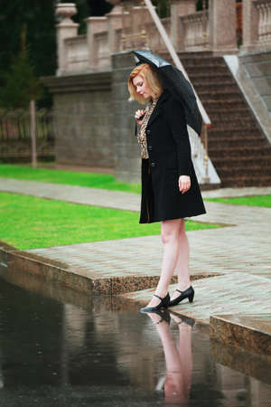 Woman with umbrella in the rain photo
