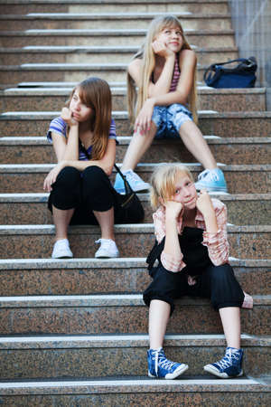 stair: Teenage girls relaxing on a steps
