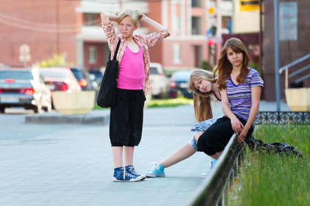 Teenage girls on the city street photo