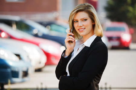 Young businesswoman calling on the mobile phone Stock Photo - 10574805