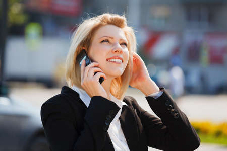 Young businesswoman calling on the mobile phone photo