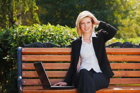 Happy businesswoman with laptop photo