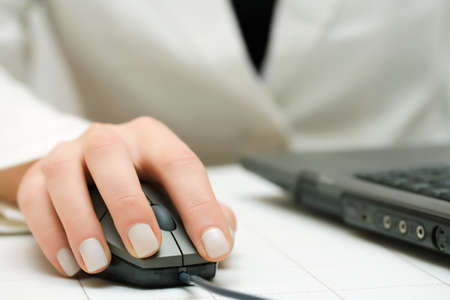 Female hands working on laptop Stock Photo - 10649798