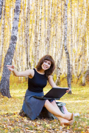 Young woman with laptop photo