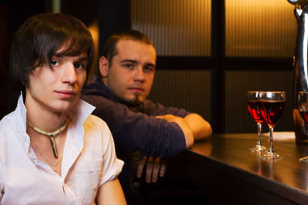 Young men relaxing on a bar counter photo