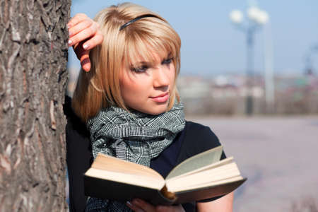 Young woman reading a book  photo